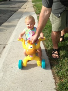 Learning to ride her trike
