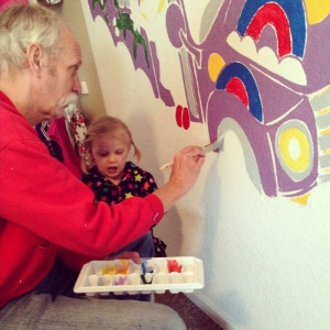 Instructing Grandpa on her bedroom mural.